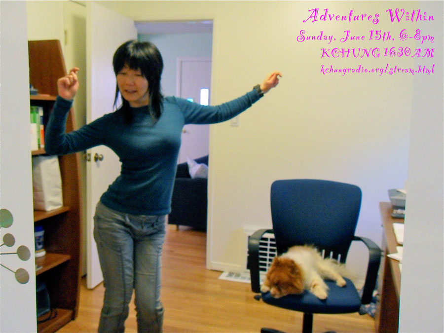 photo of Jennifer dancing in her office with Mr. Snuggles sleeping on the office chair